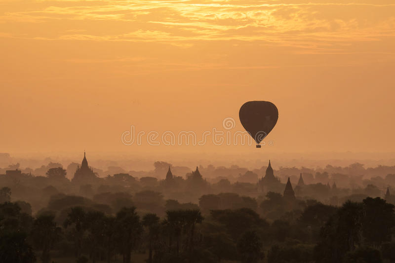 Hot air ballons over pagodas in sunrise at Bagan stock photo