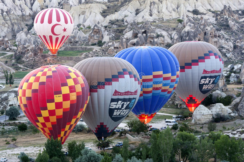 Hot air ballons prepare to take off at sunrise near Goreme in the Cappadocia region of Turkey. royalty free stock photos