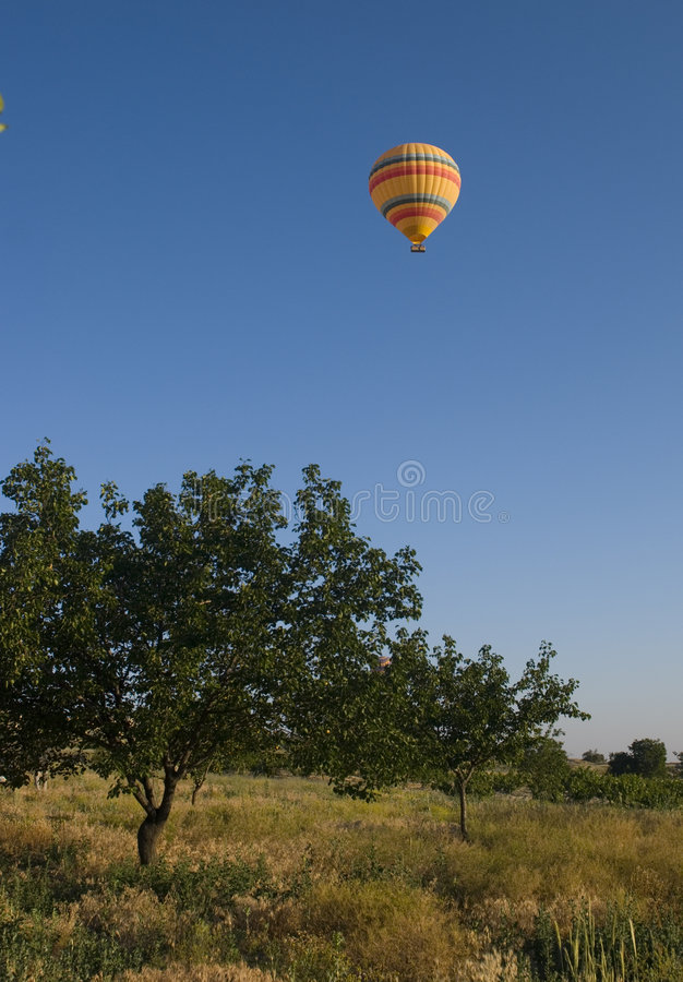 Hot air balloon. A hot air balloon in the skies stock images
