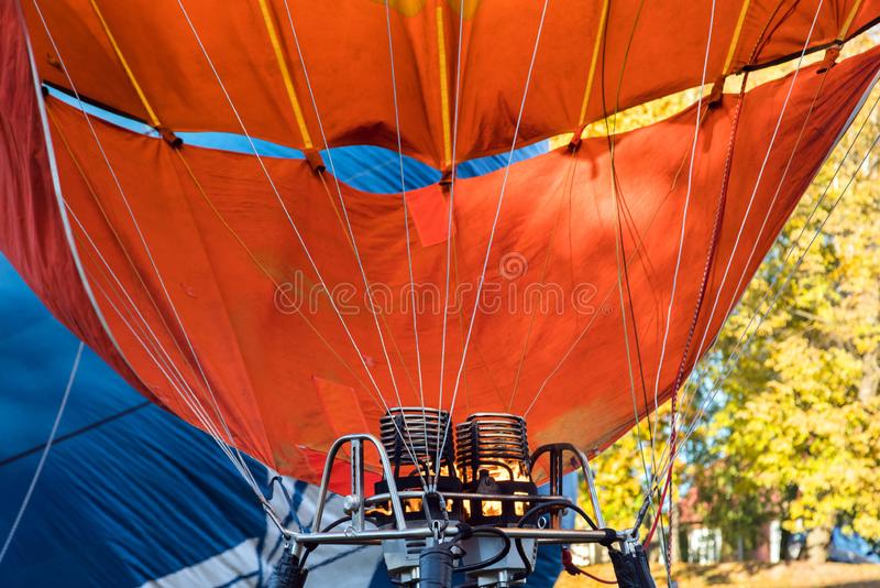 Hot air balloon. Aerostat with bright burning fire flame fueled. By gas. Close up of burner equipment royalty free stock photos