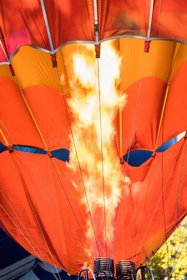 Hot air balloon. Aerostat with bright burning fire flame fueled. By gas. Close up of burner equipment royalty free stock image
