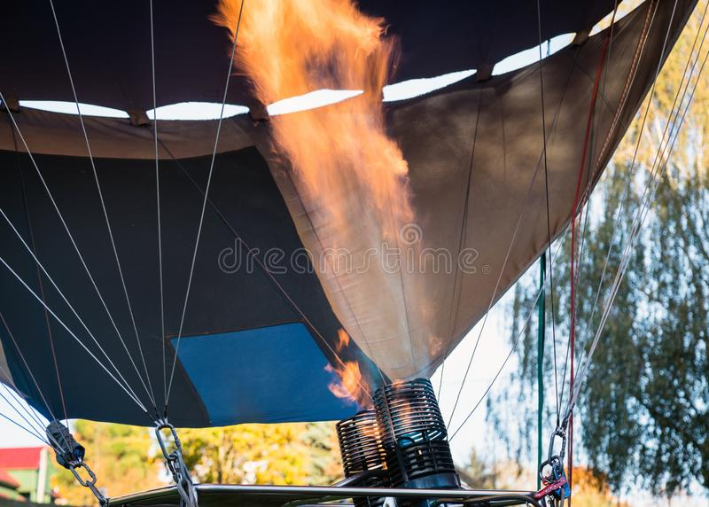 Hot air balloon. Aerostat with bright burning fire flame fueled. By gas. Close up of burner equipment stock photos