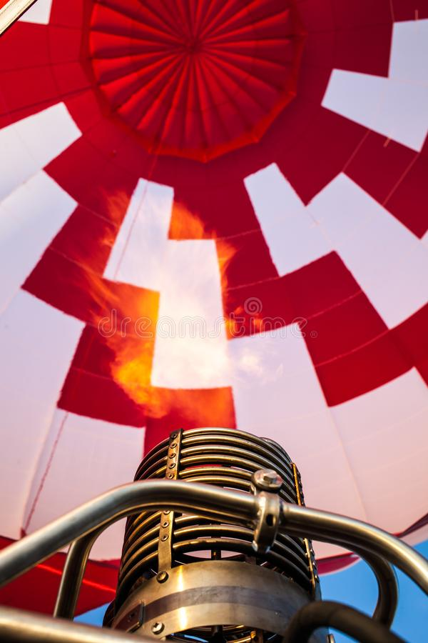 Hot air balloon or aerostat, bright burning fire flame from gas burner equipment. Close up from inside royalty free stock images