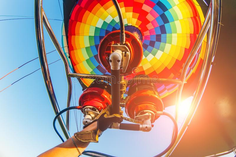 Hot air balloon or aerostat, bright burning fire flame from gas burner equipment, close up from inside.  stock photo