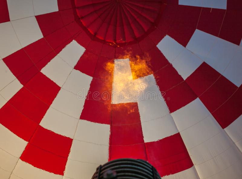 Hot air balloon or aerostat, bright burning fire flame from gas burner equipment. Close up from inside royalty free stock image