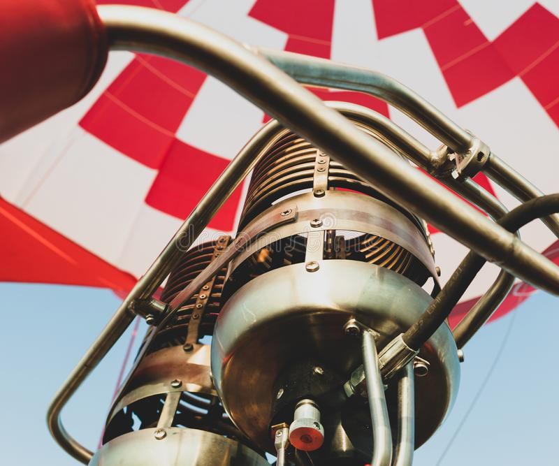 Hot air balloon or aerostat, bright burning fire flame from gas burner equipment. Close up from inside stock image