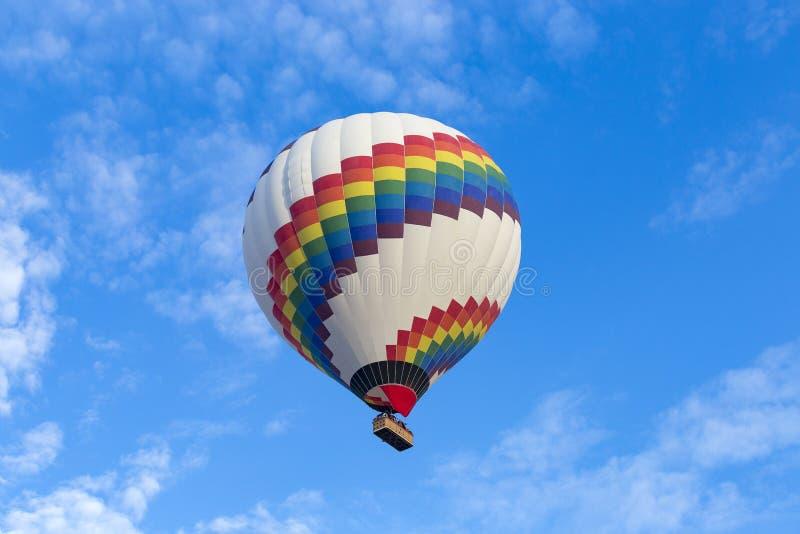 Hot air balloon against blue sky stock photo
