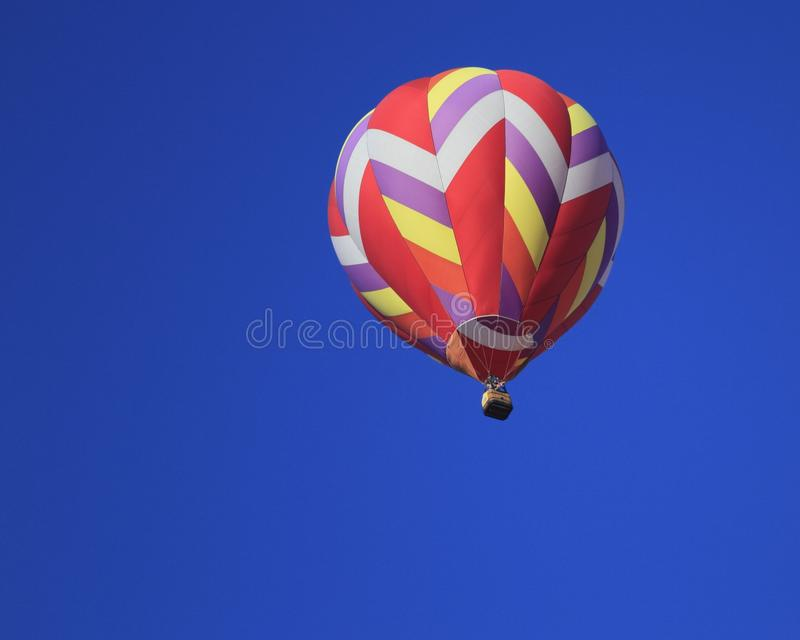 Download Hot Air Balloon Aloft In Blue Sky-Achievement Stock Photo - Image of indianola, seasonal: 25983876