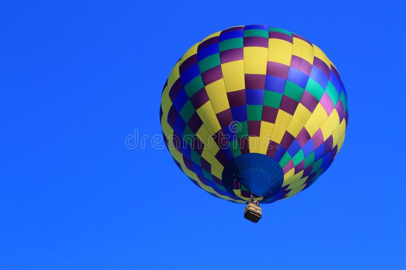 Download Hot Air Balloon Aloft In Blue Sky-Achievement Stock Photo - Image: 25983878