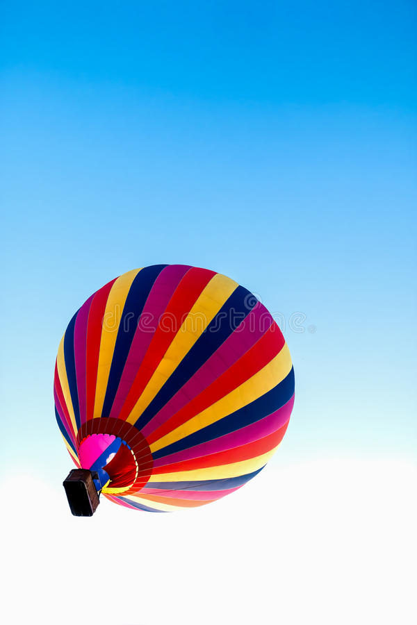 Hot air balloon. The colorful hot air balloon floats up to the sky stock image