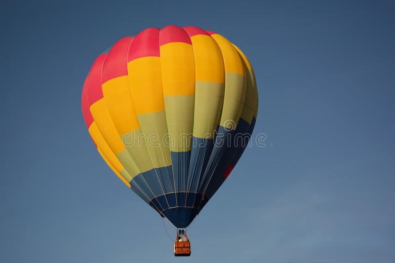 Hot air balloon colorful in sky. Hot air balloon colorful in blue sky. Freedom, flying, travel, dream concept stock image