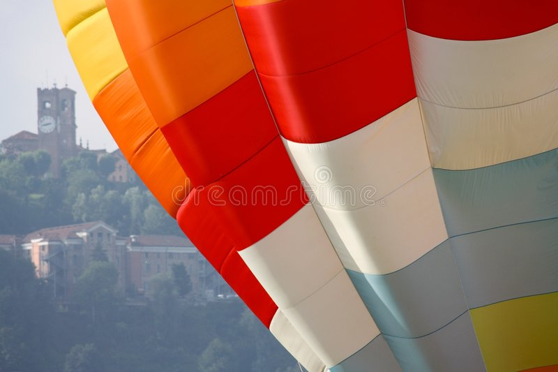 Hot air balloon, detail. Detail of a coloured hot air balloon with Mondovì in the background stock photography