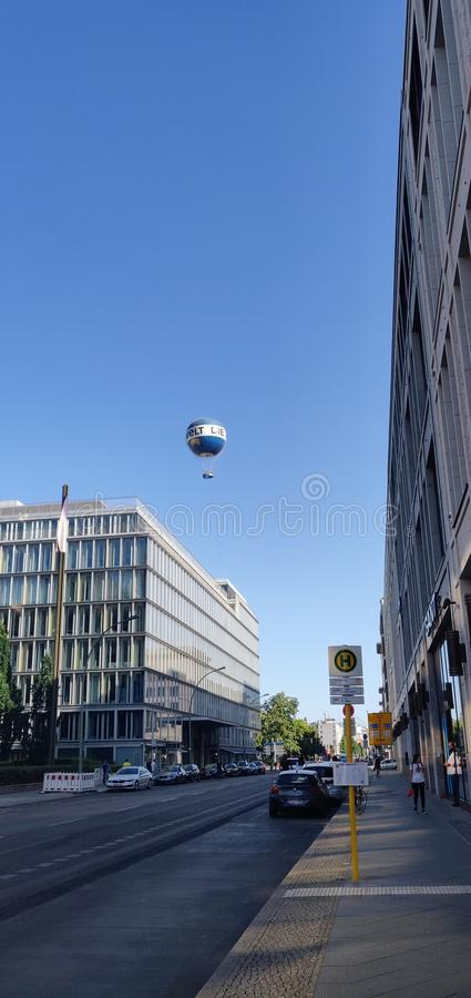 Hot air balloon in the distance of modern city royalty free stock images