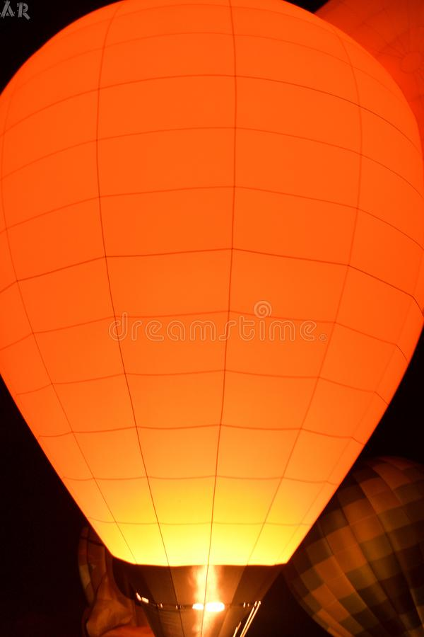 Hot Air Balloon Festival. With glowing balloon up in the air royalty free stock photography