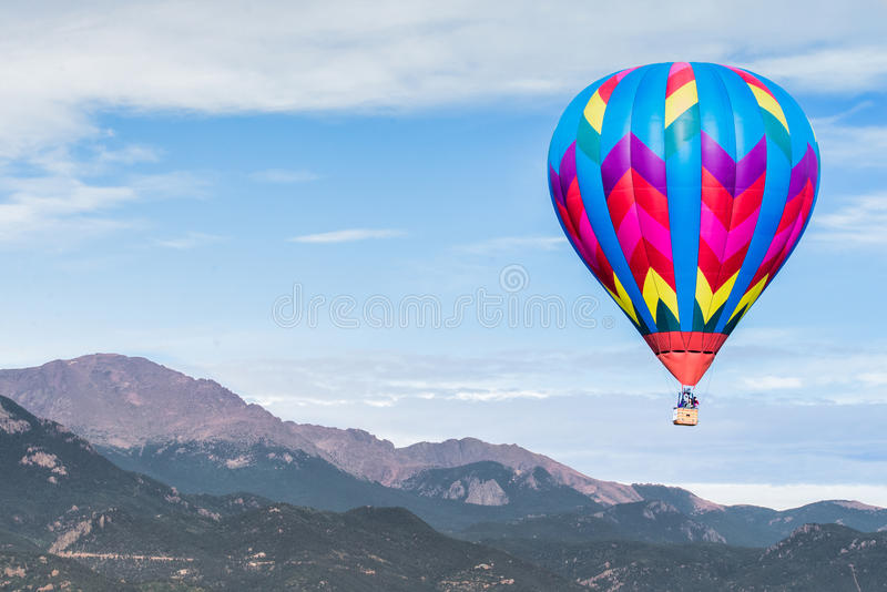 Hot air balloon festival. Hot air balloon taken at the colorado labor day lift off in colorado springs - hot air balloon festival event - colorful balloon flying royalty free stock photography