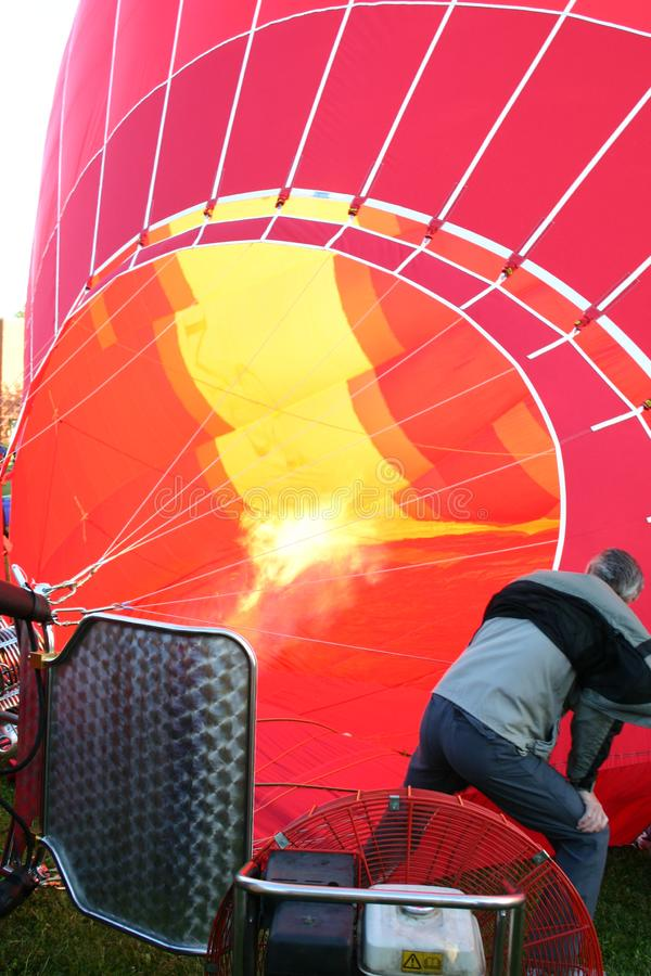 Flames are filling a hot air balloon royalty free stock photography
