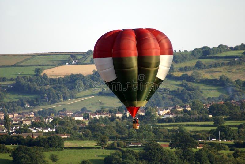 Hot air balloon flying far over Bristol city in England royalty free stock photos