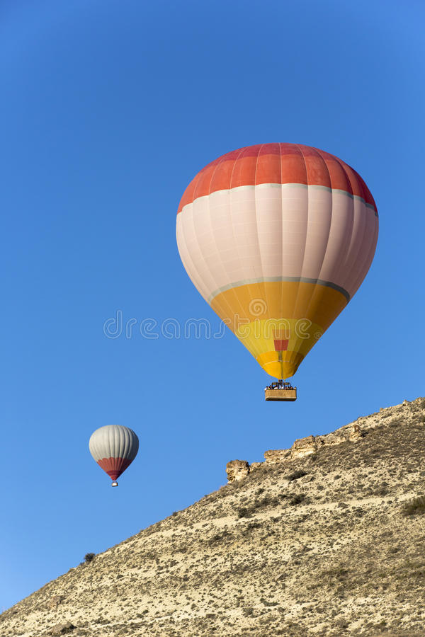 Hot air balloon flying over Cappadocia. Nevsehir, Turkey stock images