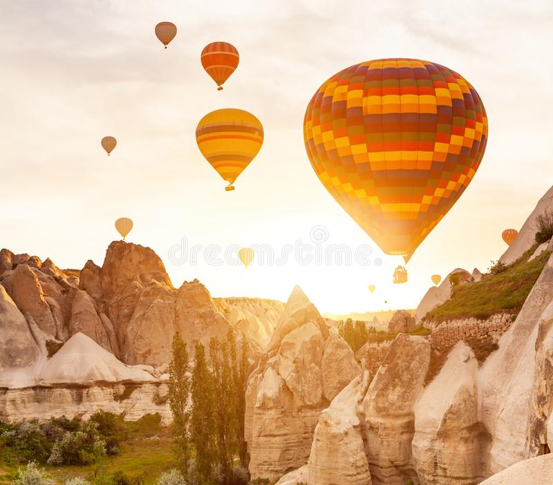 Hot air balloon flying over rock landscape at Cappadocia Turkey royalty free stock photography