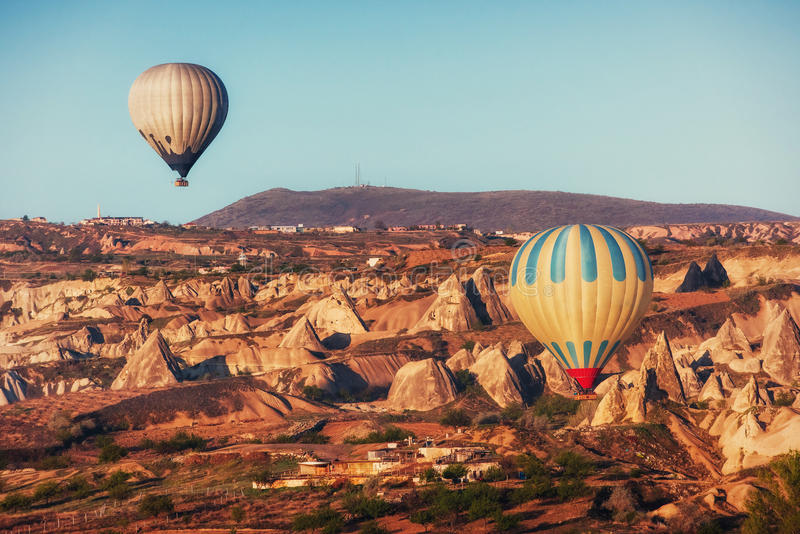 Hot air balloon flying over rock landscape at Cappadocia Turkey. royalty free stock photos