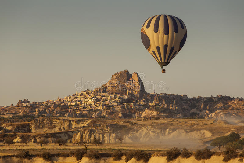 Hot air balloon flying over spectacular Cappadocia - Uchisara vi royalty free stock image