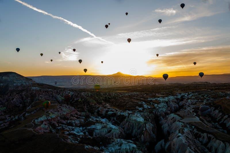 Hot air balloon flying over valleys in Cappadocia Turkey stock image