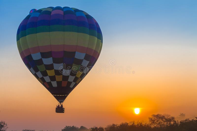 Hot air balloon flying in the sky at sunrise. Chiang Rai,Thailand - February 18,2018:hot air balloon flying above Singha park in Chiangrai Thailand. balloons royalty free stock images