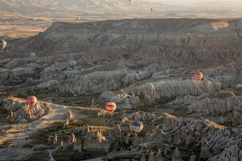 Hot air balloon flying at sunrise royalty free stock photography
