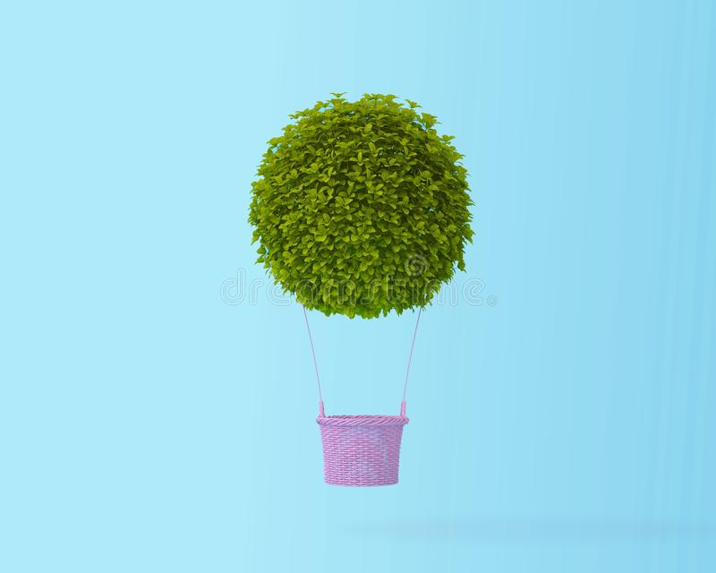 Hot air balloon green bush,grass, idea concept on pastel blue ba. Ckground with copy space for text. happy holiday flying balloons. Minimal creative concept stock photos