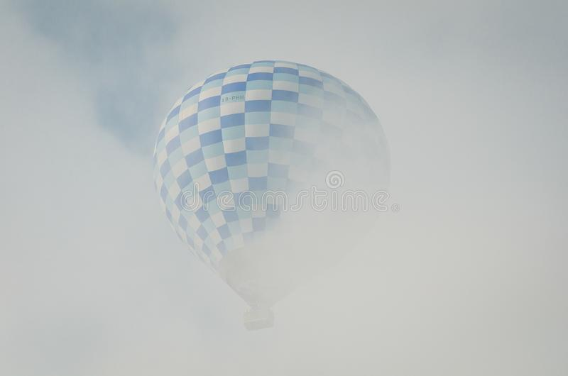 Hot air balloon in hidden in cloud in Teotihuacan stock image