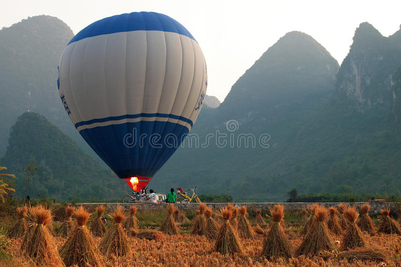 Hot air balloon among the hills and rice fields, Yangshuo, China stock image
