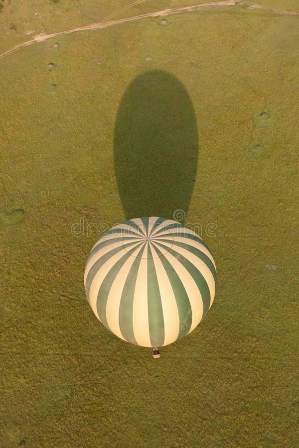 Hot air balloon and its shadow stock images