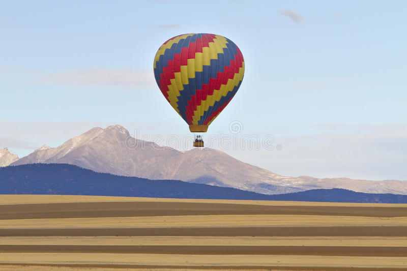 Hot Air Balloon and Longs Peak stock photos