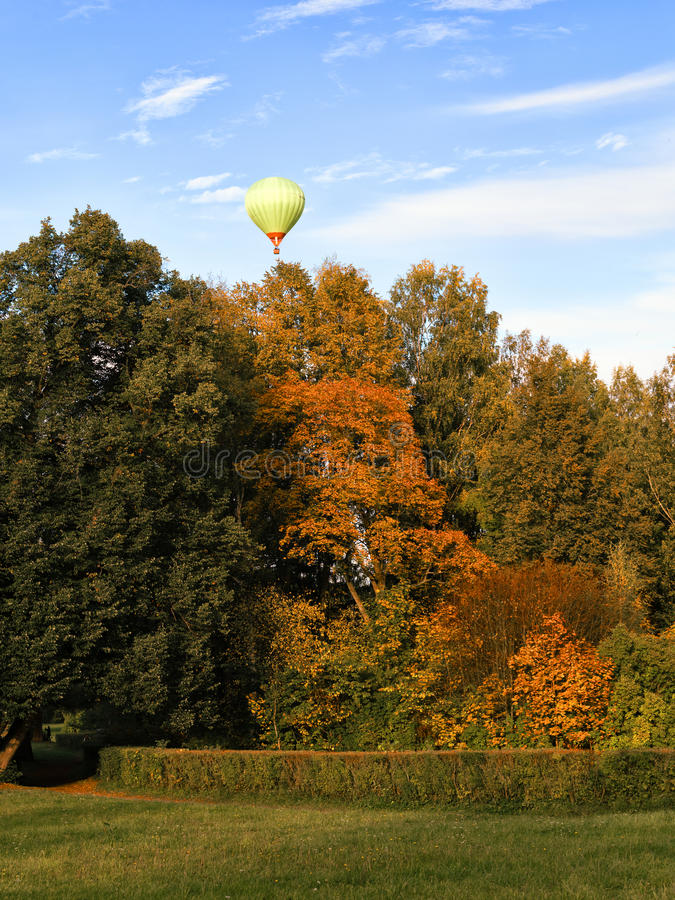 Hot air balloon over the autumn Park in Pavlovsk royalty free stock photo