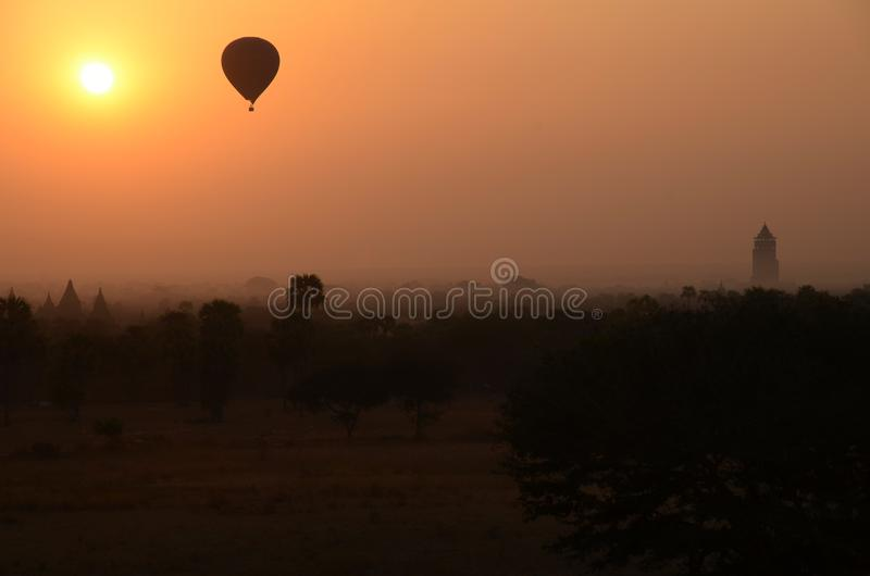 Hot-air balloon over Bagan during sunrise stock photos