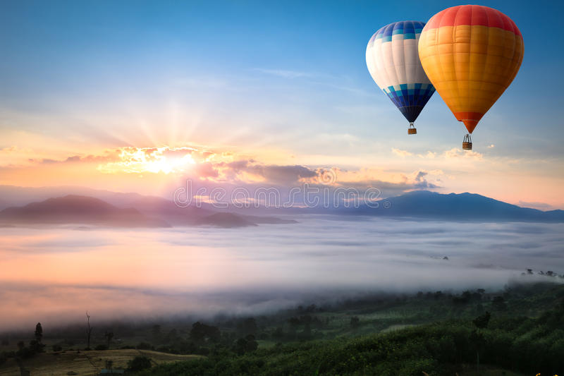 Hot air balloon. Over sea of mist