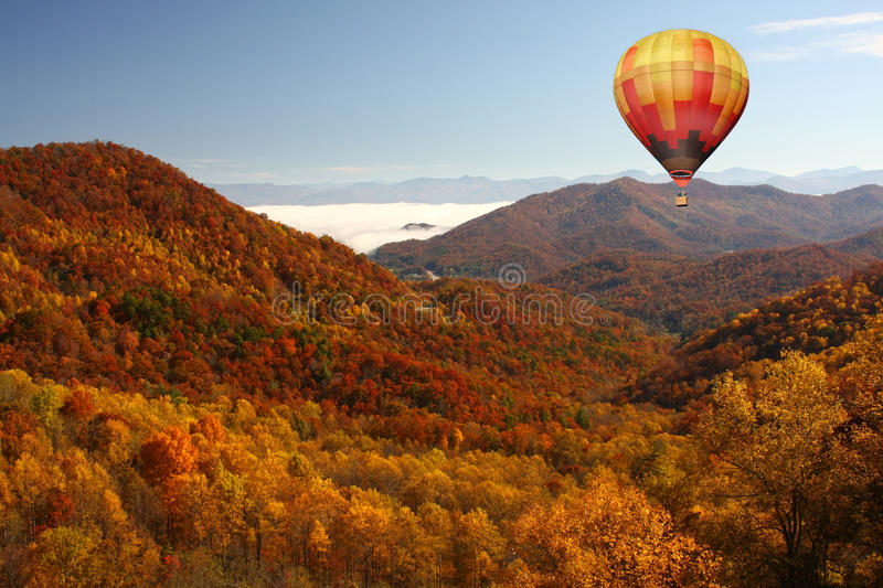 Hot air balloon over smokey mountains in the fall royalty free stock photos