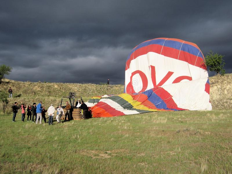 Hot air balloon ride – get off from Ark - Cappadocia - Turkey. Landing Hot air balloon ride - Get off in pasture after fall with dark clouds stock photography