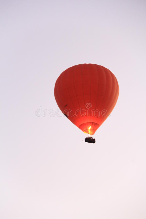 Hot Air Balloon rising high. Hot air is being filled with gas burner flame to lift up and raising high royalty free stock images