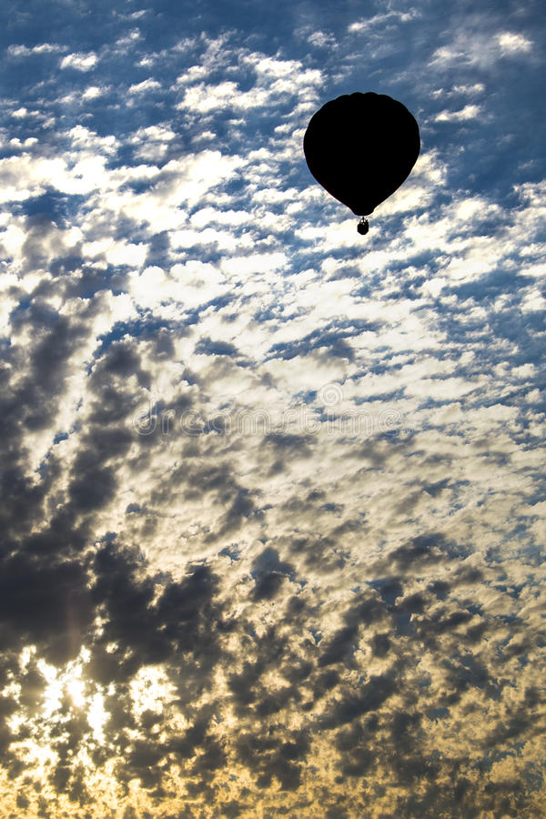 Hot air balloon rising at sunrise. stock images