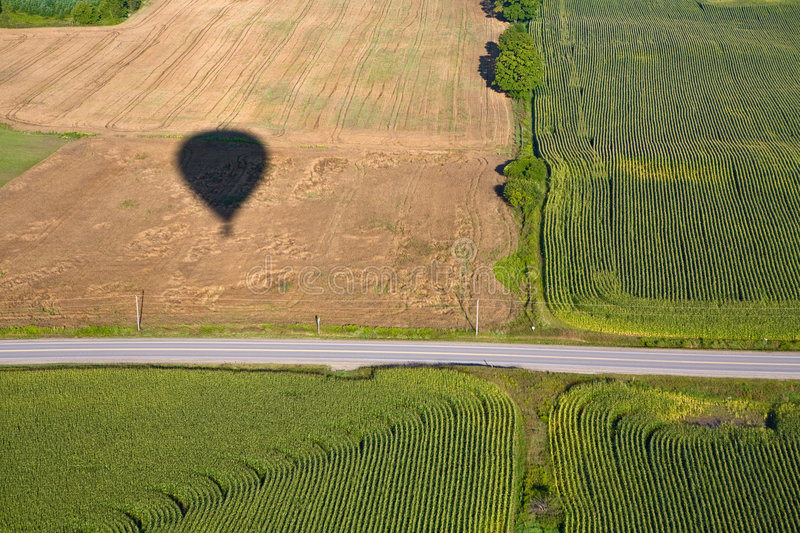 Download Hot Air Balloon Shadow On Field With Road. Stock Image - Image: 7597105