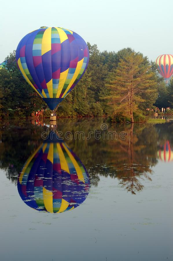 Hot air balloon touching the water stock photos