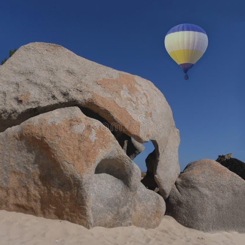 Hot air balloon. Hot air balloon tour over rocks stock photography