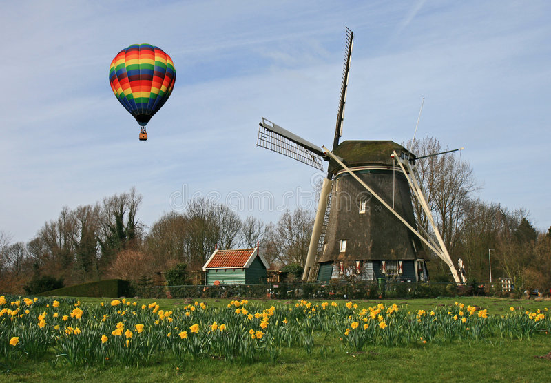 Hot air balloon and Windmill stock photo