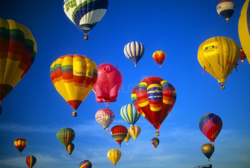 Hot air balloons agaisnt blue sky stock image