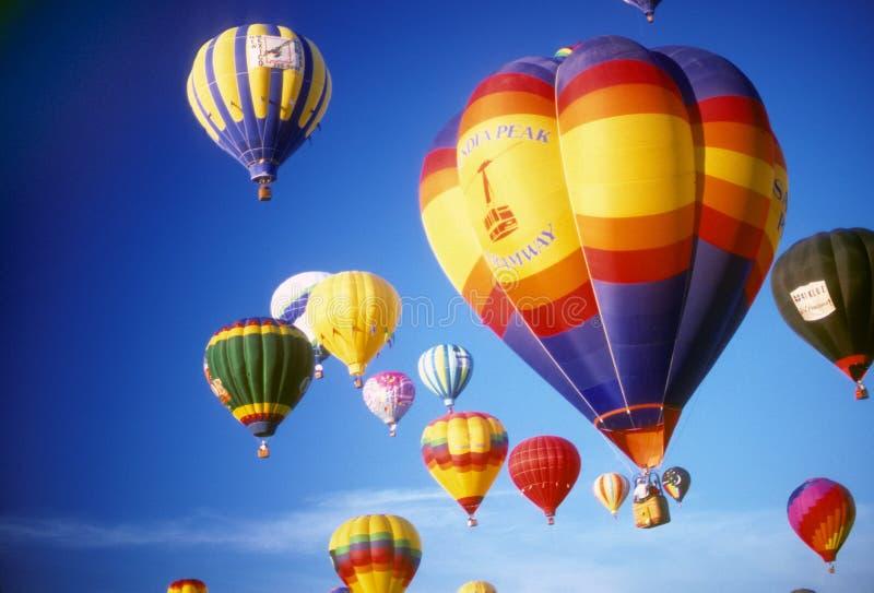 Hot air balloons agaisnt blue sky stock photos