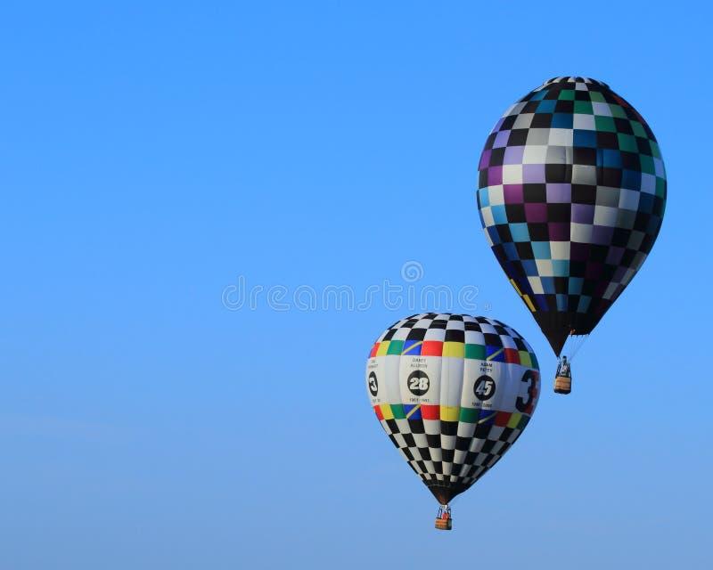 Hot Air Balloons Aloft in Blue Sky-Achievement stock photos