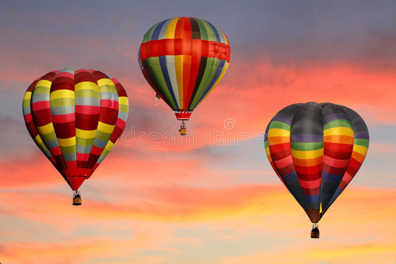 Hot Air Balloons Ascending at Sunrise stock images