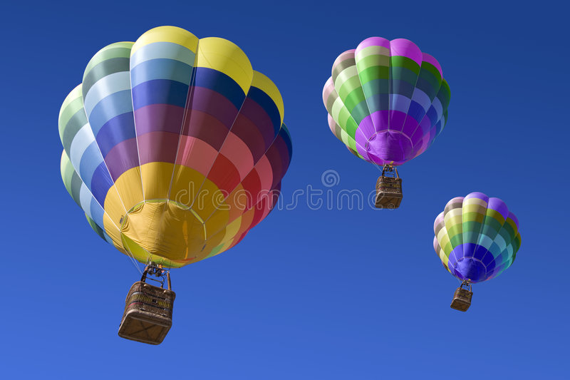 Hot air balloons in the blue sky. Three Hot air balloons in the blue sky in Spain stock photography