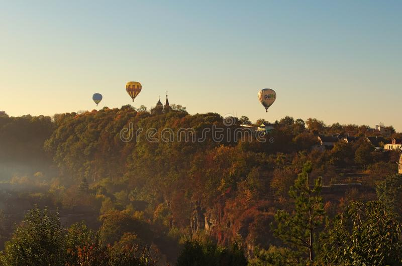 """Hot Air Balloons Festival `Gold Omega 2018"""". Three hot air balloons are flying near Kamianets-Podilskyi castle royalty free stock photography"""
